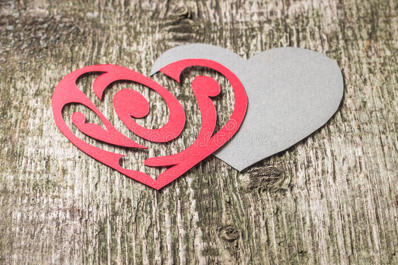 Red Ornament Paper Heart wih Paper Shadow on wood royalty free stock photo