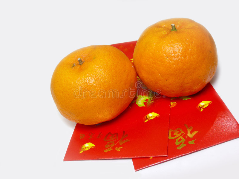 Red packets with mandarin oranges royalty free stock image