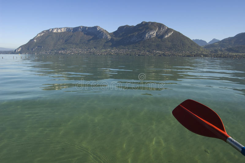 Red paddle of canoe and Annecy lake royalty free stock photos