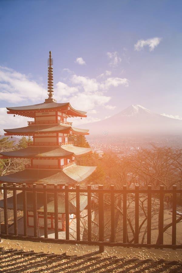 Red pagoda temple with Fuji volcano. Mountain background, Japan landmark stock photo