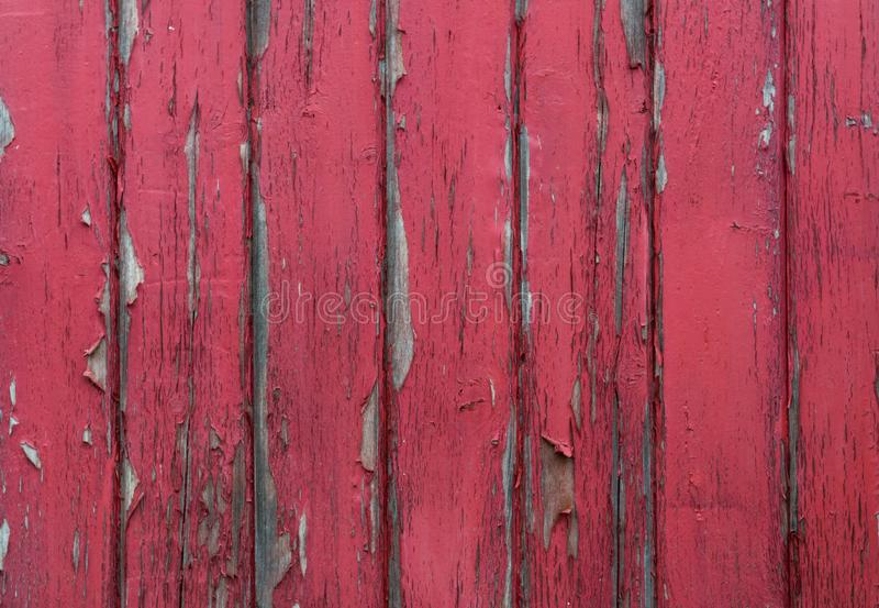 Red Paint Chipping Off Wood Panel Wall. On old building royalty free stock photography