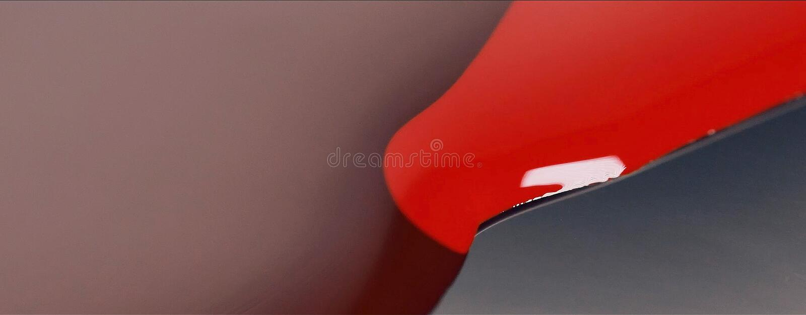 Red paint lipstick liquid texture, oil paint for painting, mixing shades, art make up cosmetic for face mix color.  royalty free stock image