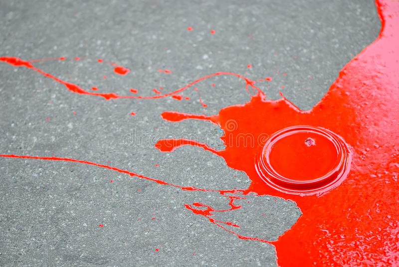 Red paint puddle stock photography