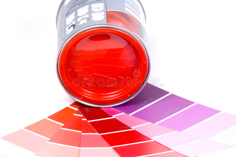 Red paint and swatches. Bright coloured paint and some swatches royalty free stock photography