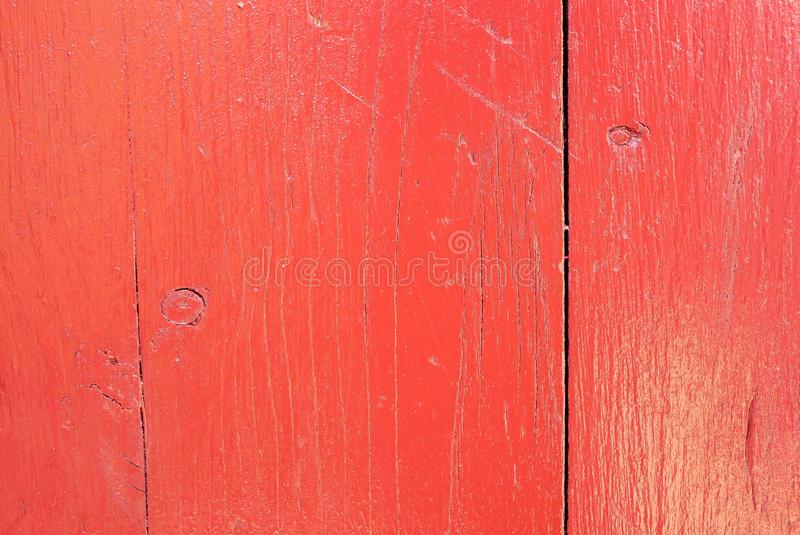 Red painted, cracked pine wood board close up shot royalty free stock photo
