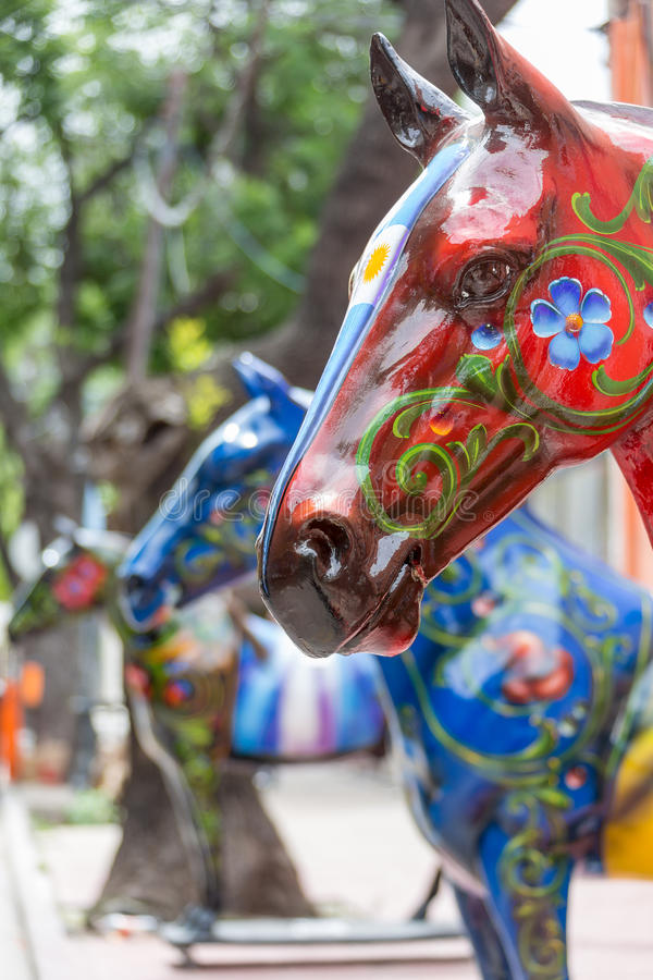 Red Painted Horse Art Statue in La Boca. A statue of painted horses in La Boca District of Buenos Aires, Argentina stock image