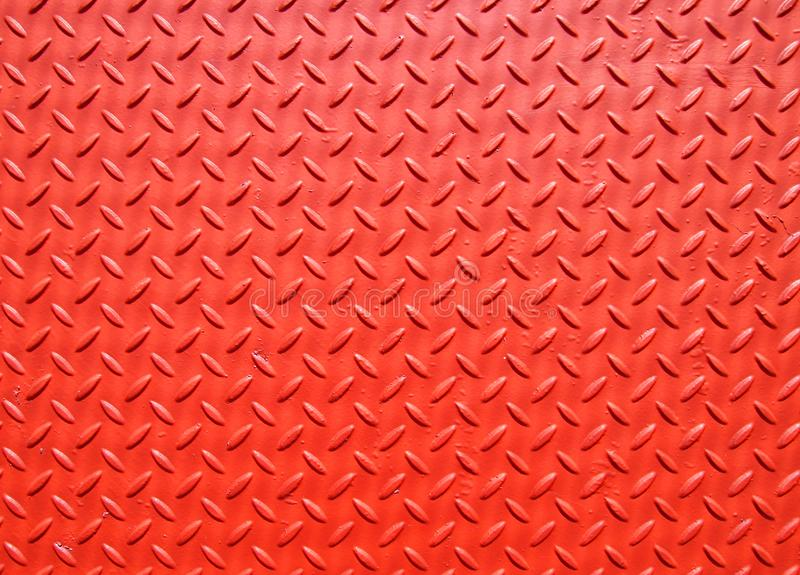 Red painted industrial metal plate industrial diamond pattern grip texture stock photo