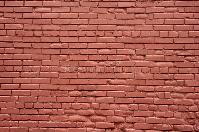 A red painted old brick wall on an old building stock photo