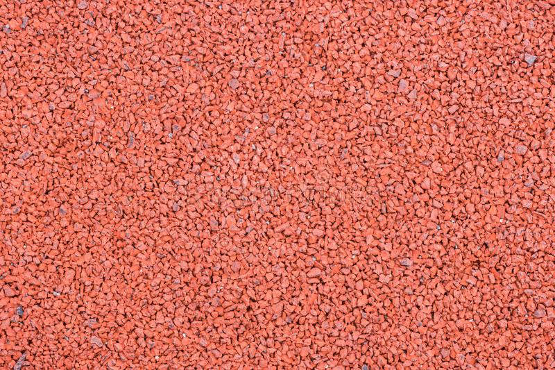 The red painted rubber playground pavement background texture royalty free stock photo
