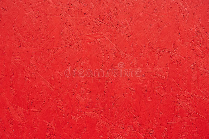 Red painted wood chipboard texture background. Close up royalty free stock photo