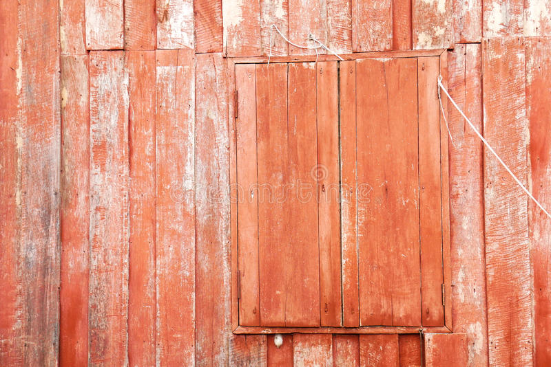 Red painted wood of old traditional wooden thai house with closed window stock photos