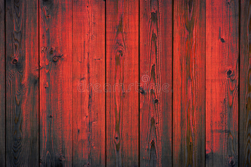 Red painted wooden peeling off planks, texture background royalty free stock photography