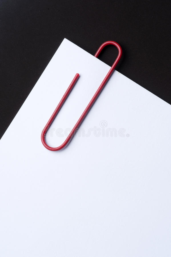 Download Red paper clip and paper stock photo. Image of supply - 28008416