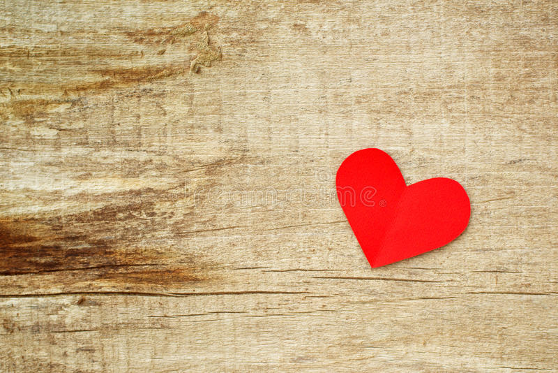 Red paper heart on grunge wooden background stock photo