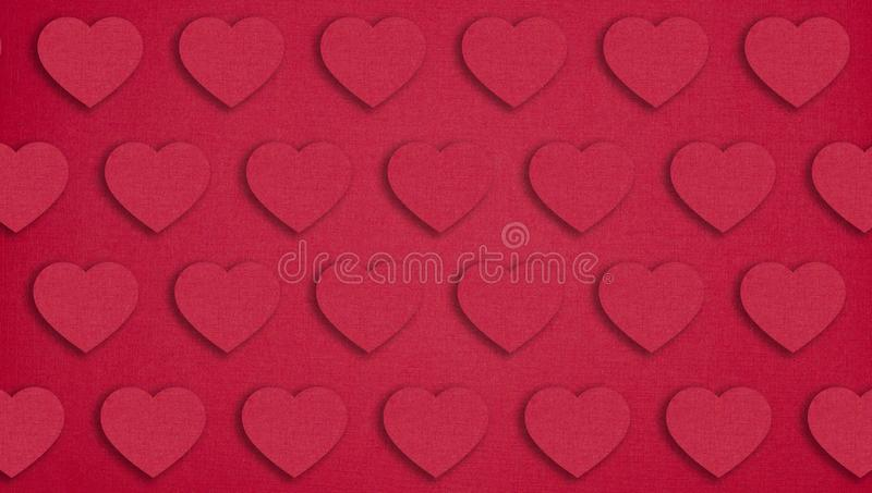 Red paper hearts on red background. Valentine`s day concept stock photos