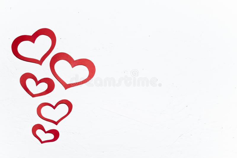 Red paper hearts. A gift for a loved one on Valentine`s day. Copy space for text stock image