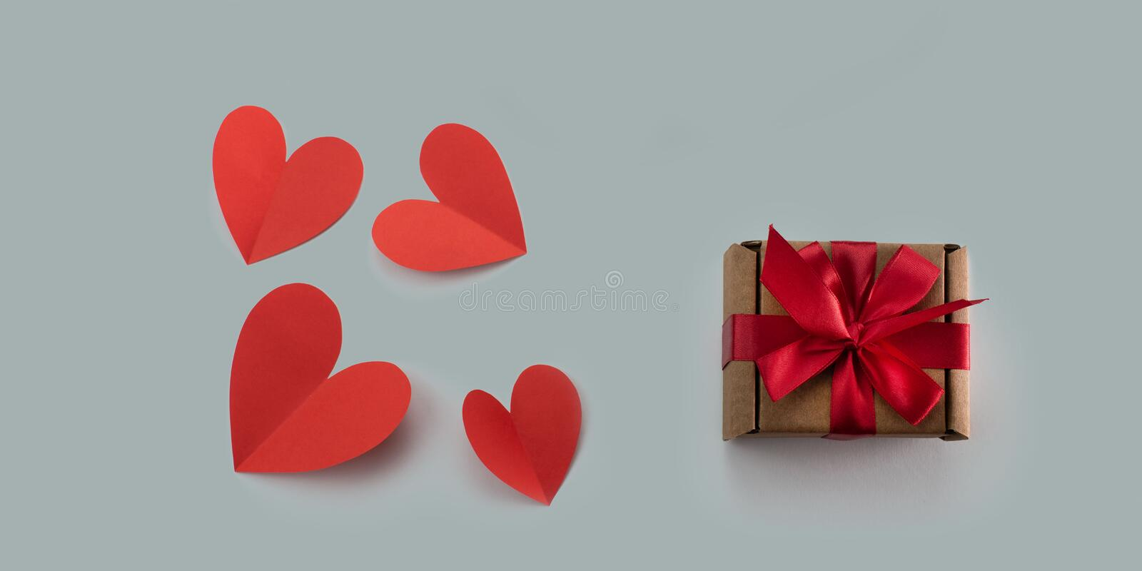 Red paper hearts gray background concept of Valentine& x27;s day stock photos
