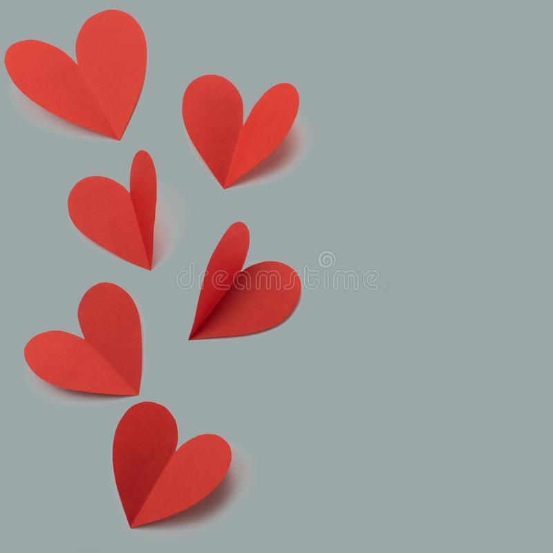 Red paper hearts on gray background concept of Valentine's day royalty free stock image