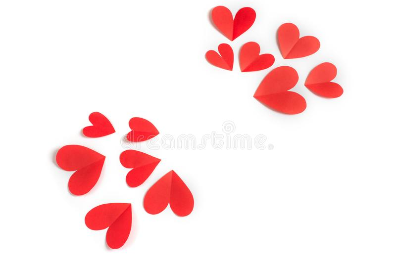 Red paper hearts on white background concept of Valentine's day stock photography