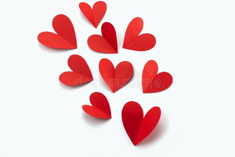Red paper hearts on white background concept of Valentine's day royalty free stock images