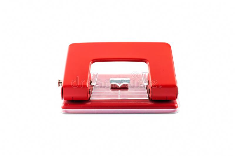 Red paper hole puncher, isolated on white background stock photos