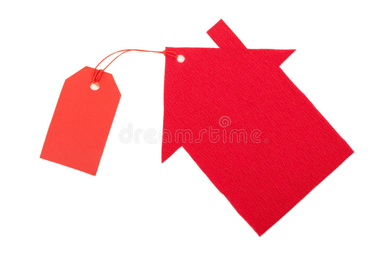 Red paper house with tag. On white stock images
