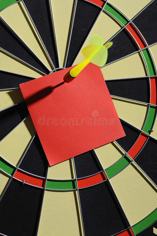 Red Paper Note With Dart Arrow. On dartboard. You can put your message on the paper royalty free stock images