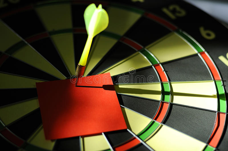Red Paper Note With Dart Arrow. On dartboard. You can put your message on the paper stock photos