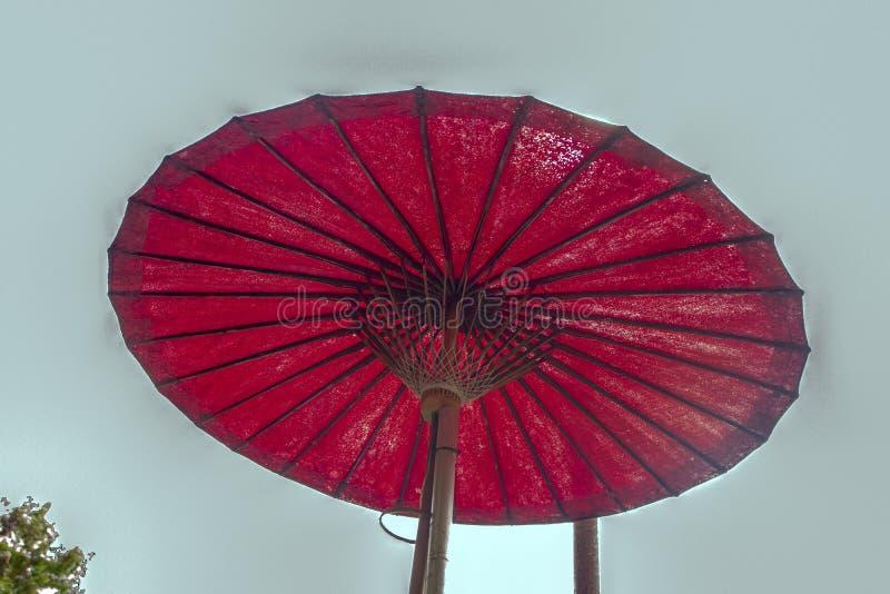Wat Pan Tao. Red paper umbrella in the garden of Wat Pan Tao, beautiful old wooden teak temple in Chiang Mai, Thailand stock image
