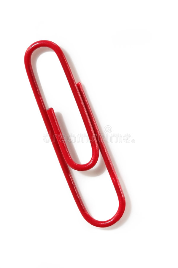Red Paperclip. Macro of red paperclip, casting shadow on white background stock photo