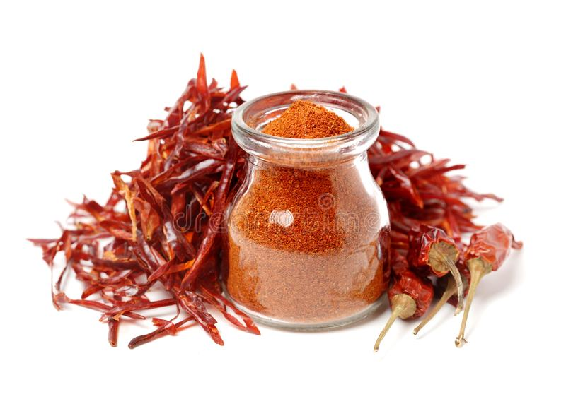 Red paprika powder and Dried hot chili peppers royalty free stock photos