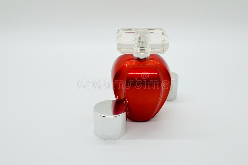 Red parfume bottle on white background with clear cap royalty free stock photography
