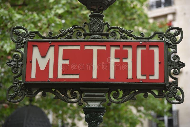 Red Paris metro subway entry sign stock photos