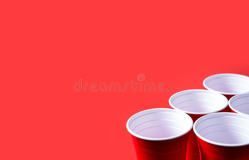 Red party cup and beer pong tournament background template. royalty free stock photos