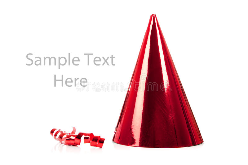Download A Red Party Hat And Streamer On White Stock Photo - Image: 12041226