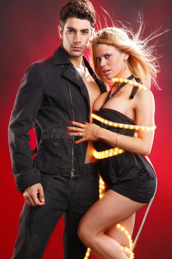 Red passion. Passionate couple show their affection stock images
