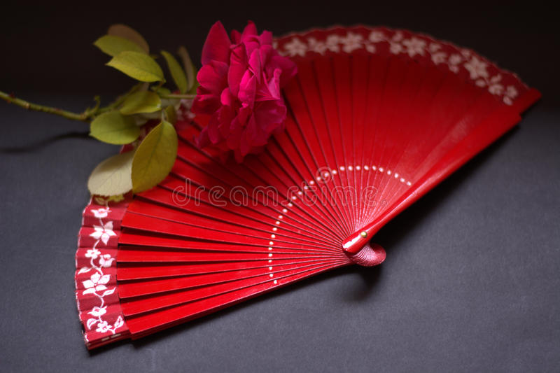 The red passion and the fan. Red to the pink and red abanico stock photography