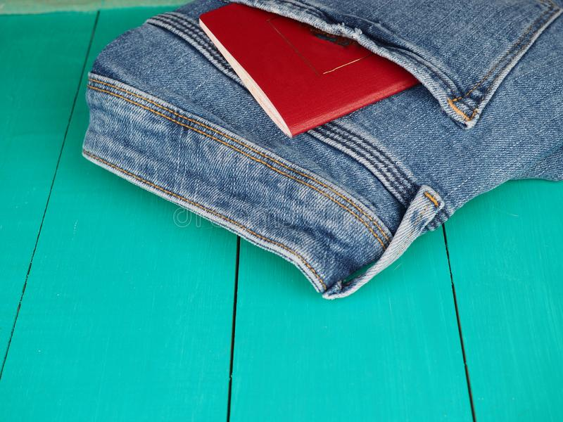 A red passport of Russia sticking from a pocket of blue denim jeans. Russian passport, Russian tourist travel concept stock photo