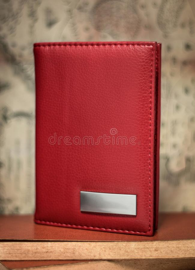 Red passport wallet on vintage background. Template of leather wallet for your design. Red passport wallet on vintage background. Template of leather wallet stock image