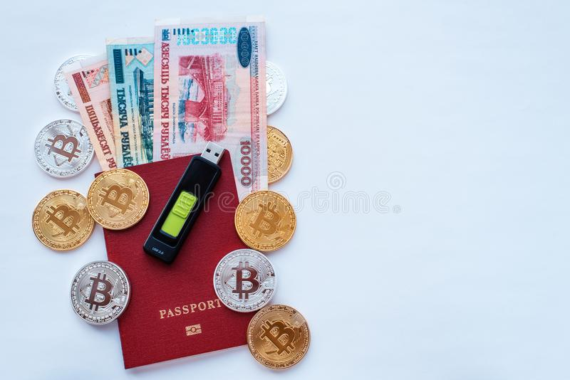 Red passport white background, Belarusian rubles with a memory card, digital currency bitcoin, gold coins, cold wallet stock images