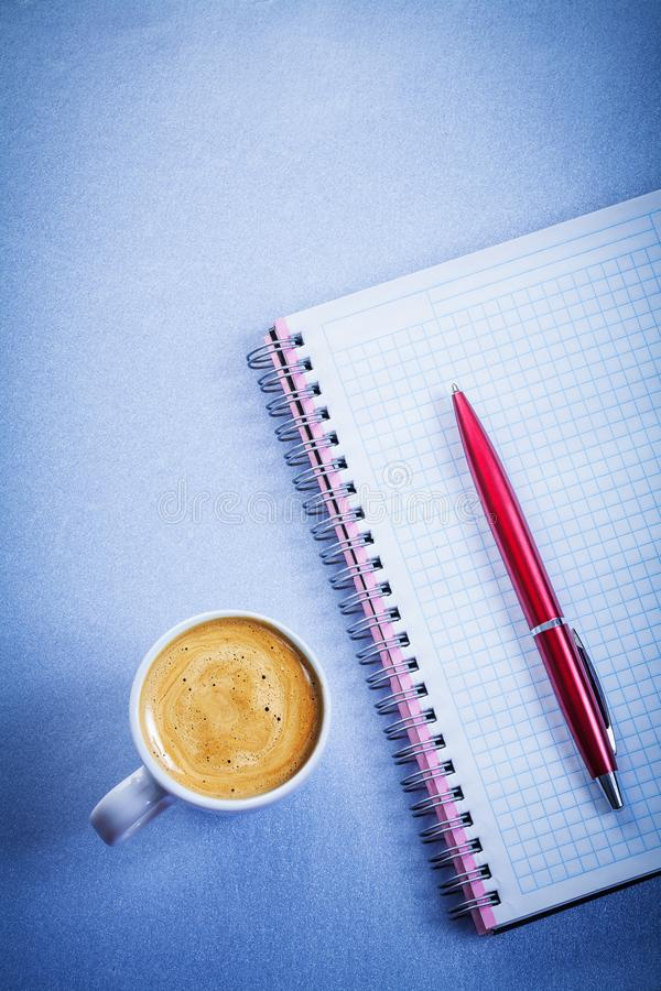 Red pen message pad white coffee cup office concept stock photo