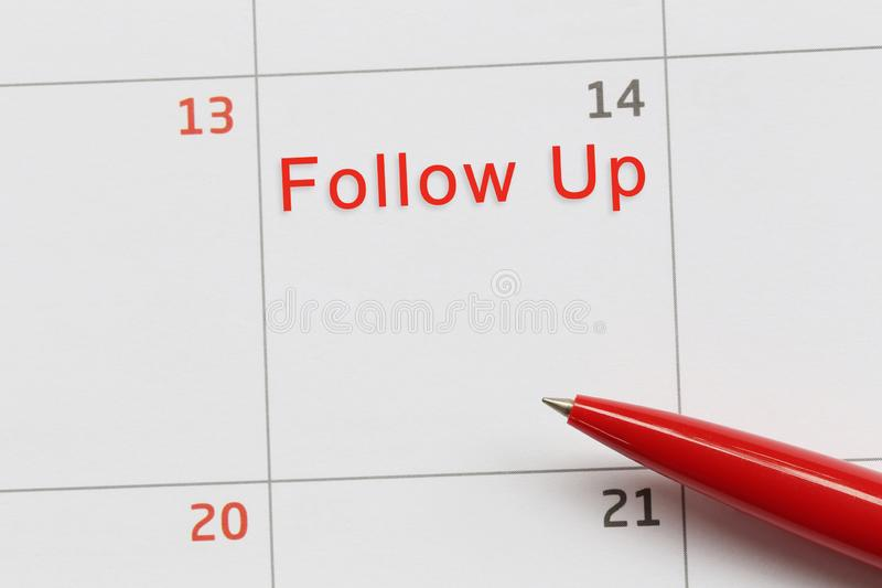 Red pen point to a empty space on the calendar and have follow up text royalty free stock image