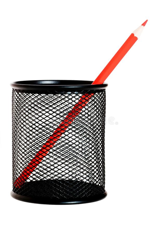 Red pencil in black pencil holder stock image
