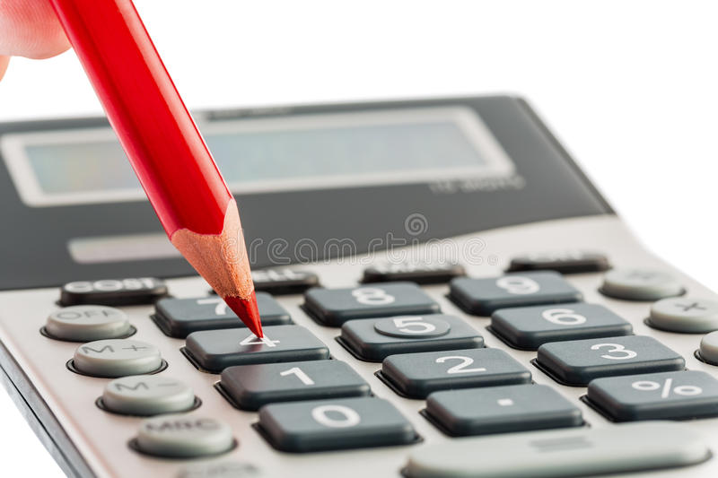 Red pencil and calculator royalty free stock image