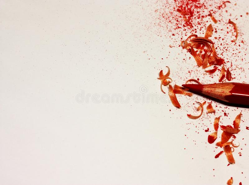Red Pencil and crayon shavings close-up with place for your text or other design elements. stock photography