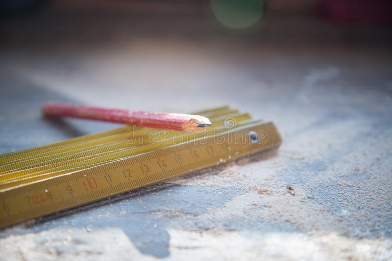 Red Pencil on Gold Metal Rulers royalty free stock images