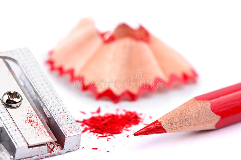 Red pencil and sharpener royalty free stock photo