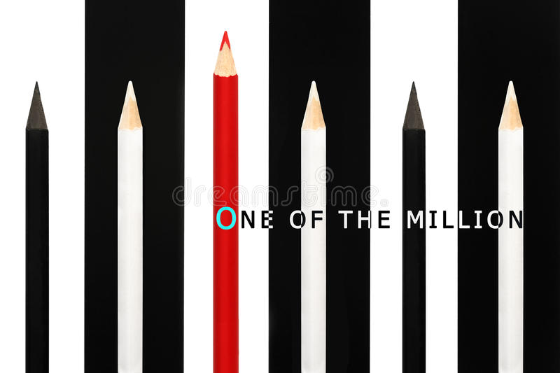 Red pencil standing out from crowd of black and white fellows on bw stripe background. business success concept of leadership royalty free stock photos