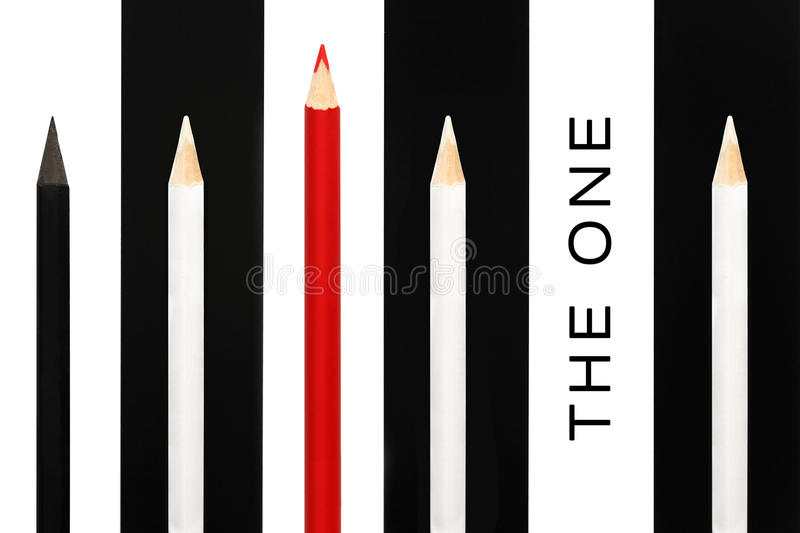 Red pencil standing out from crowd of black and white fellows on bw stripe background. business success concept of leadership stock photos