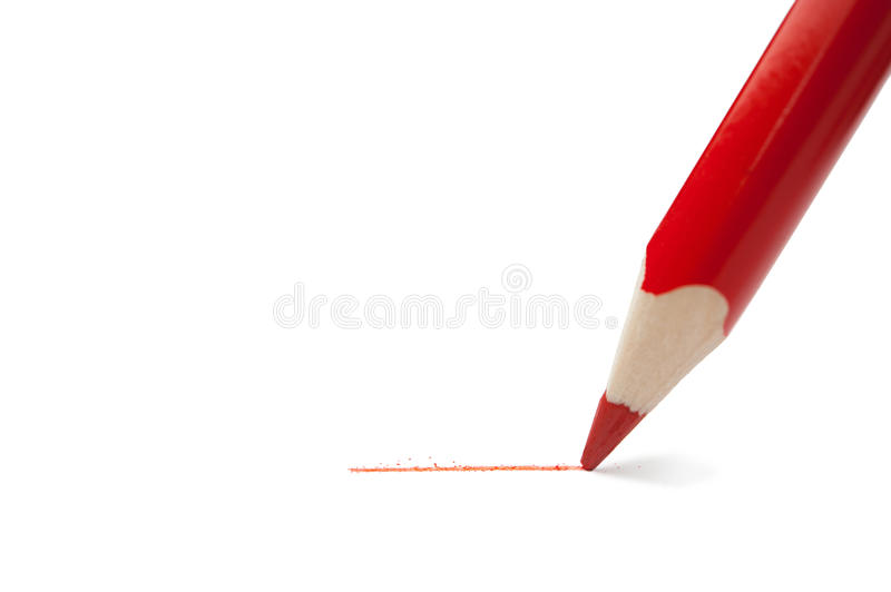 Red pencil. Red pencil writes on paper stock photo